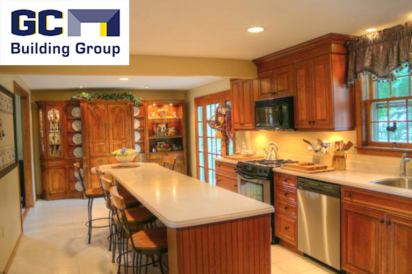 Photo of kitchen remodeled with large island