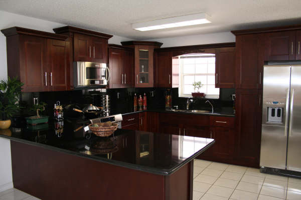 Cherry kitchen cabinets for kitchen remodel by general contractor in Broward County, FL